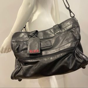 TUMI leather duffle/weekender bag with adjustable shoulder strap